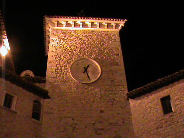 The clock tower at the 14th century Castello Brancaleoni in Piobbico, one of our concert venues.