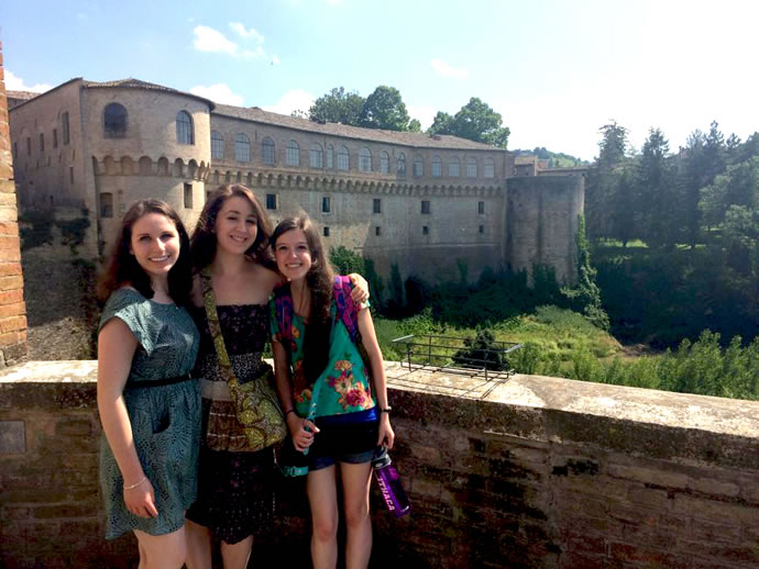 Jessica Newman, Addie Rose Brown, and Leanne Averill in front of Urbania's majestic Palazzo Ducale.